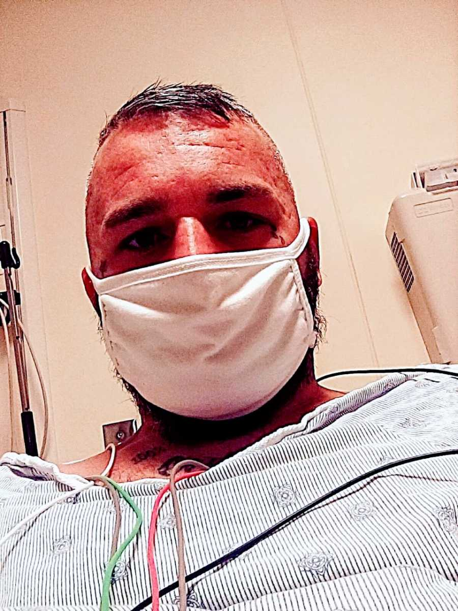 Man recovering from a violent attack takes a selfie in the hospital with a mask on