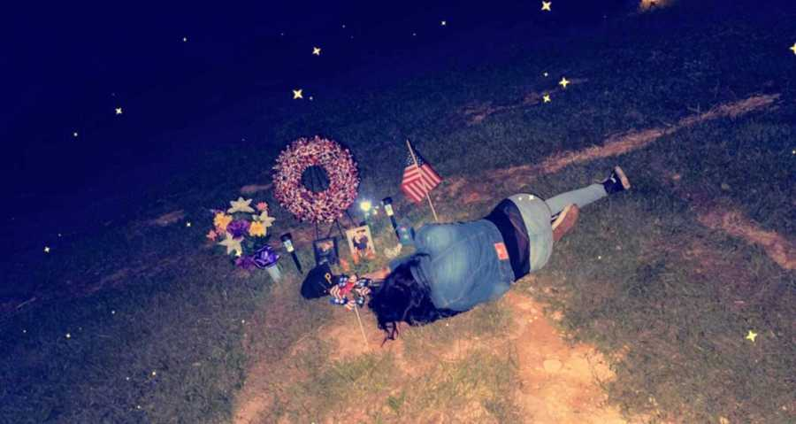 Woman lays next to her late boyfriend's memorial after he lost his life to a stroke