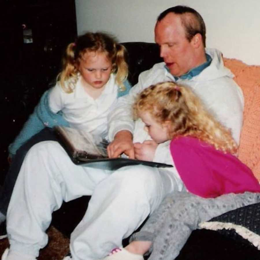 two young girls with their dad