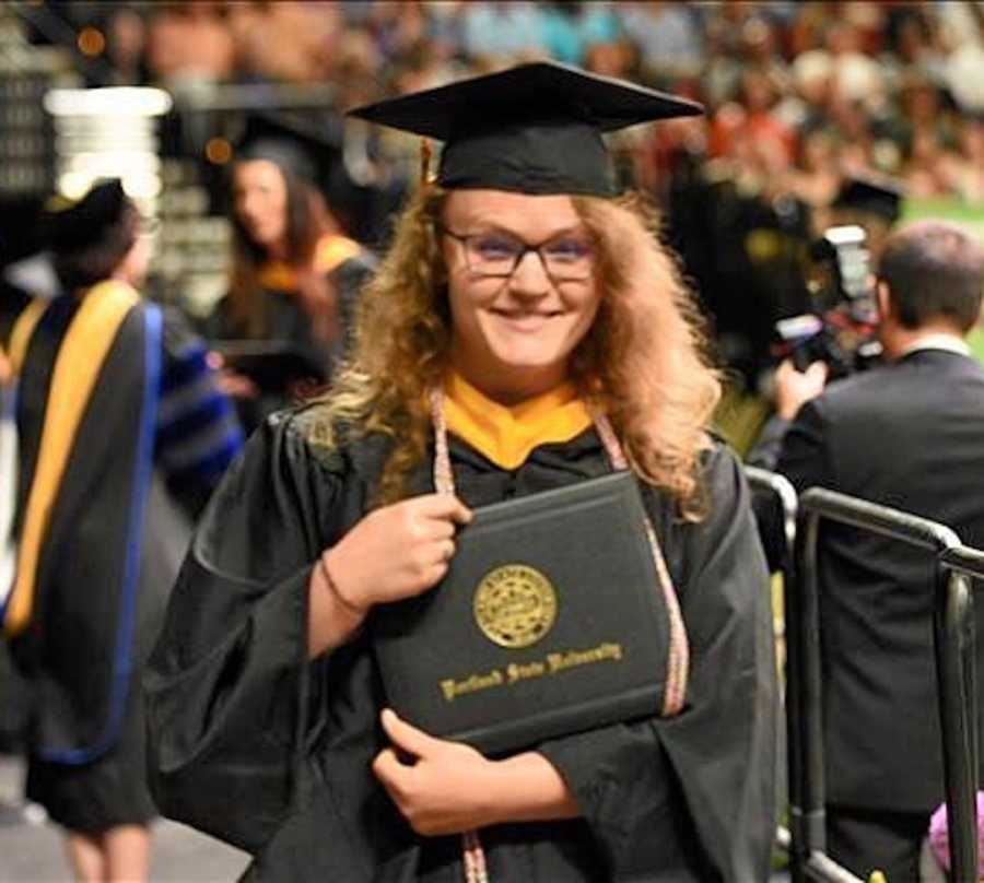 woman graduating college- cap and gown