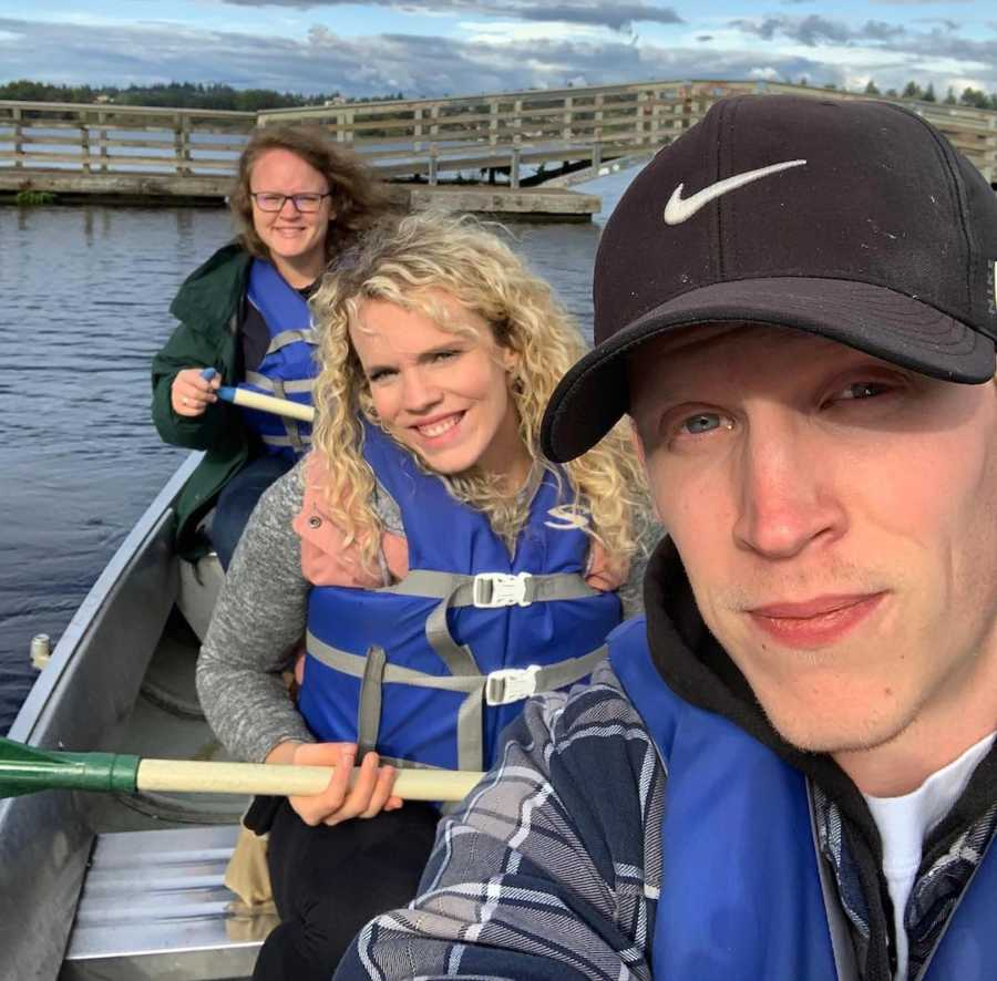 woman with two siblings outside on boat