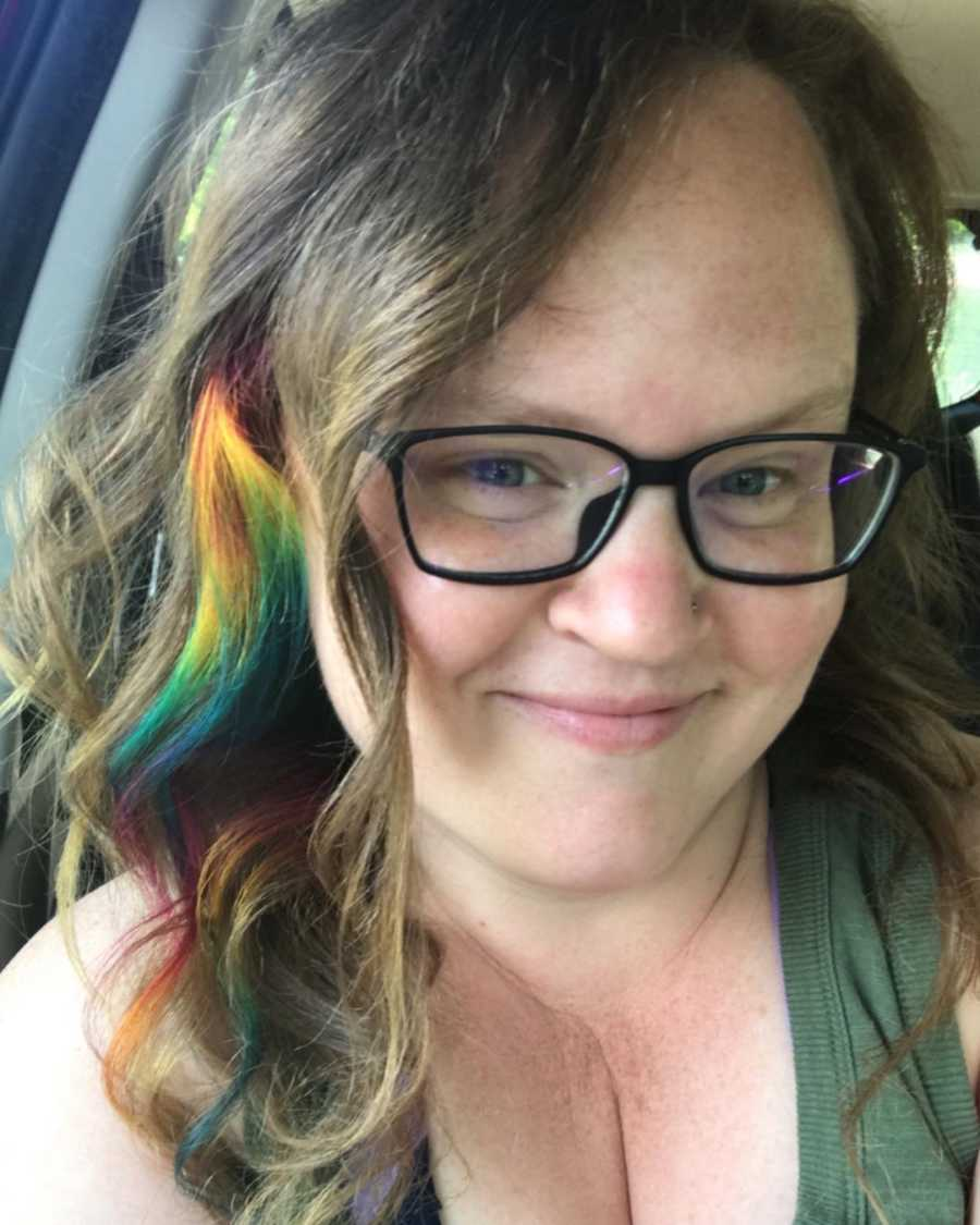 woman with rainbow streak in hair