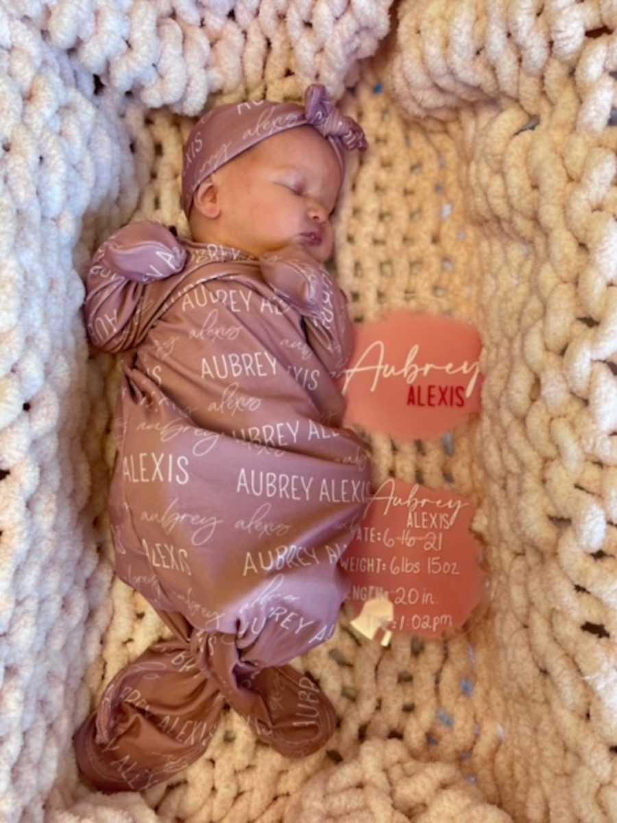 baby girl in cradle