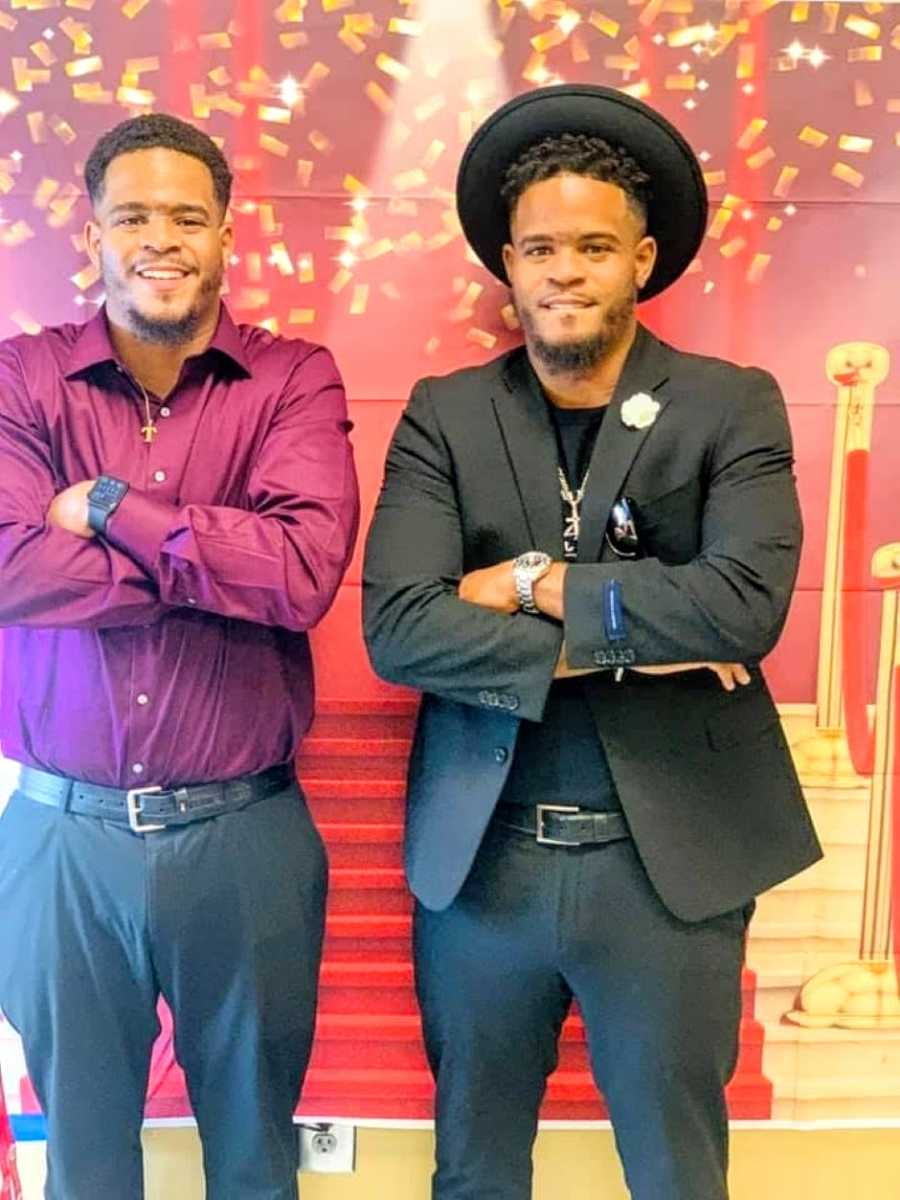 Twin brothers pose for a photo together dressed up in church attire