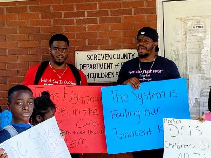 Twin brothers protest against the broken foster care system