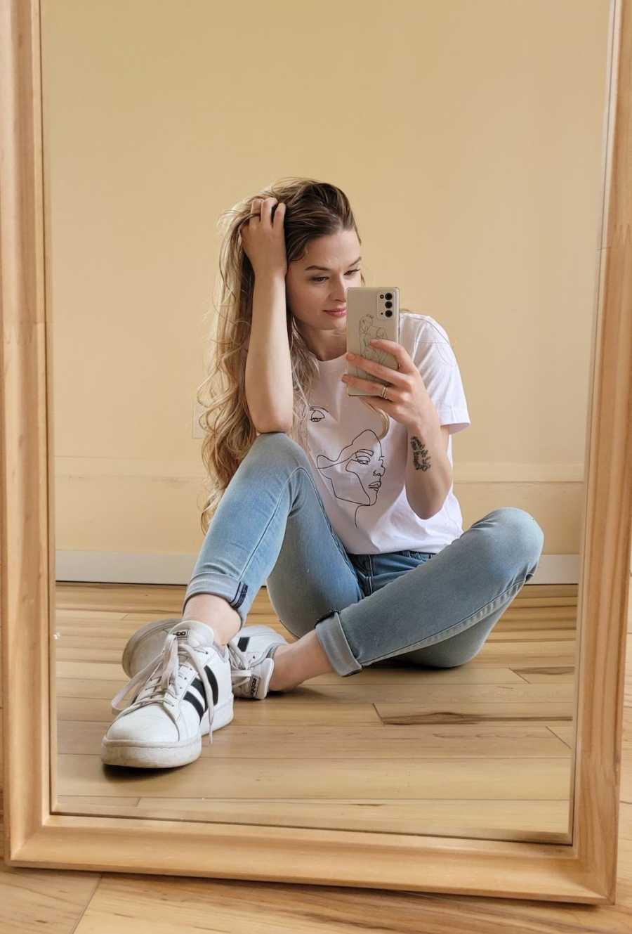 girl taking mirror selfie
