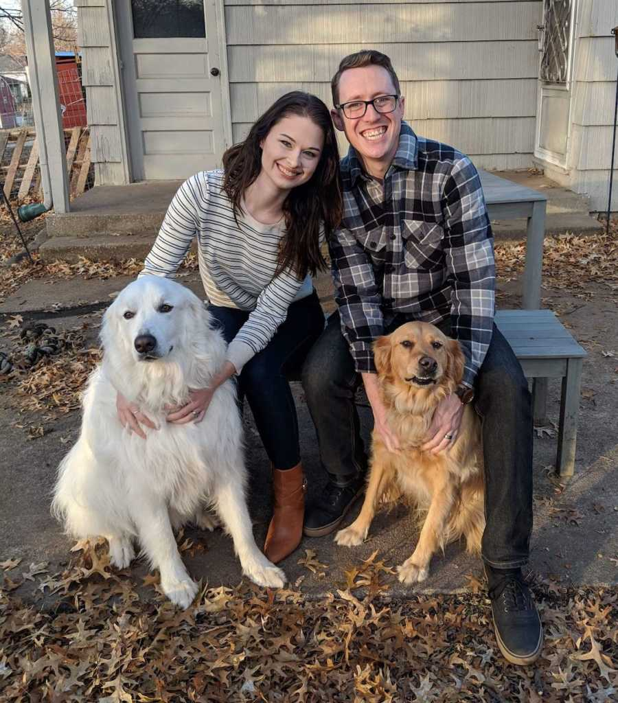 couple with two dogs