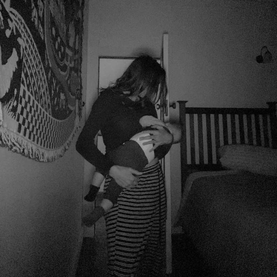 mom cradling her newborn baby