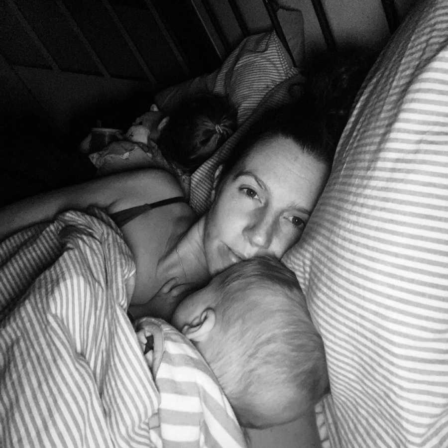 mom in bed with her newborn baby
