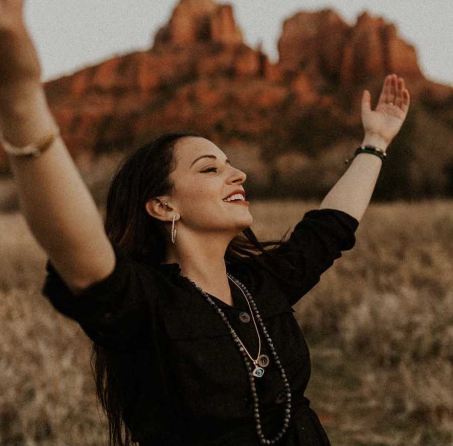 Woman raising hands in happiness