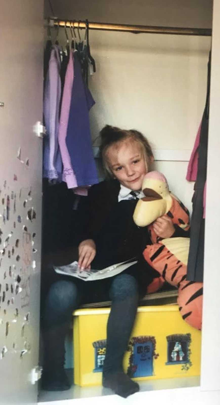 young girl in a closet