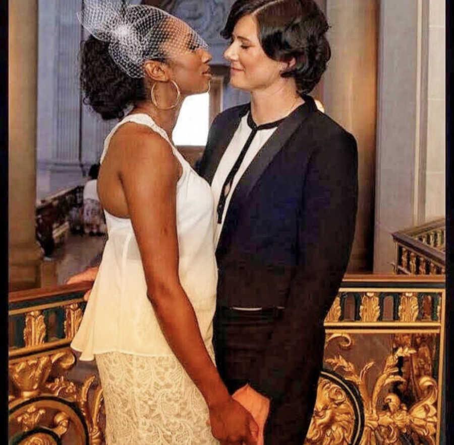 Lesbian couple kissing at their wedding