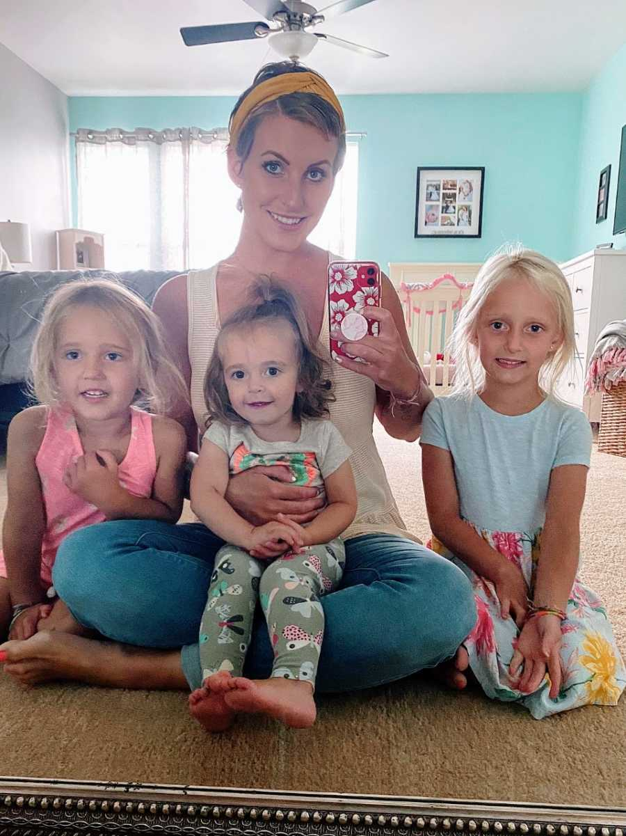 Mom recovering from breast cancer takes a mirror selfie with her three daughters