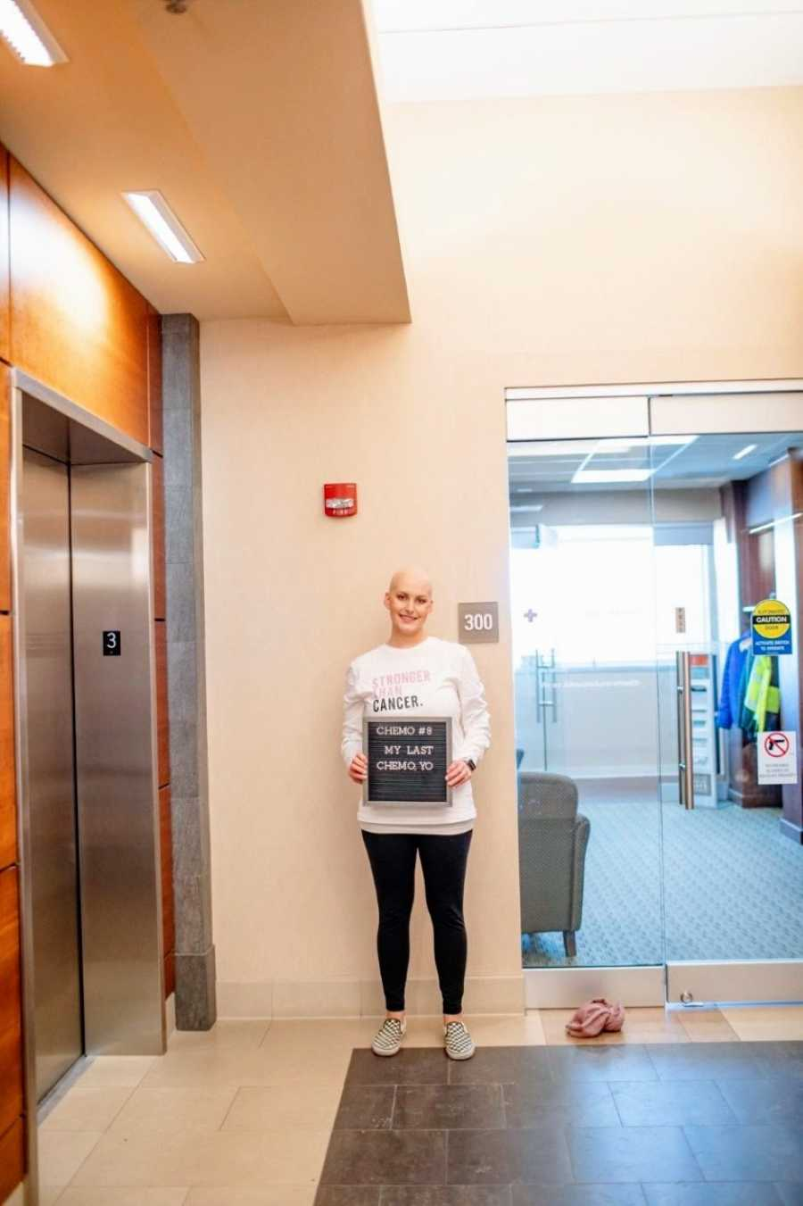 Woman with triple negative breast cancer celebrates her last chemo treatment