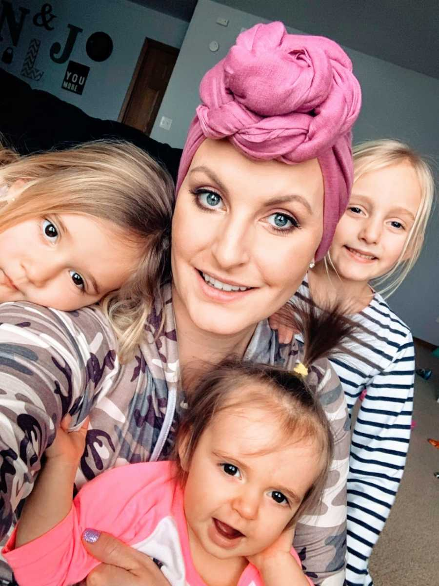 Mom recovering from triple negative breast cancer takes a beautiful selfie with her three daughters