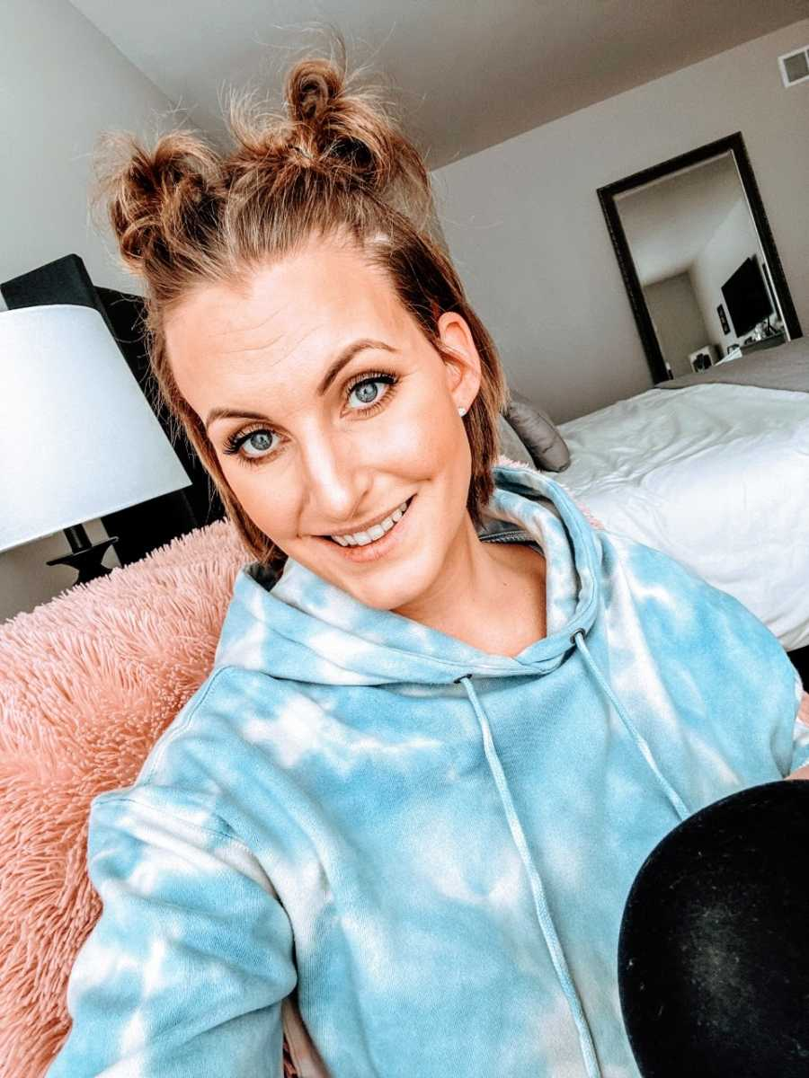 Woman recovering from triple negative breast cancer puts her hair in space buns