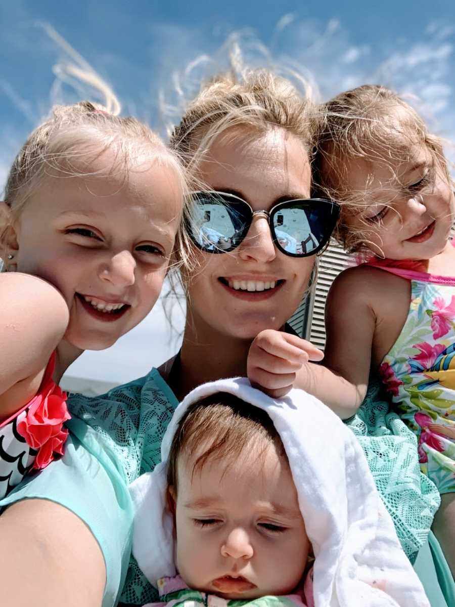 Mom takes a beach selfie with her three daughters