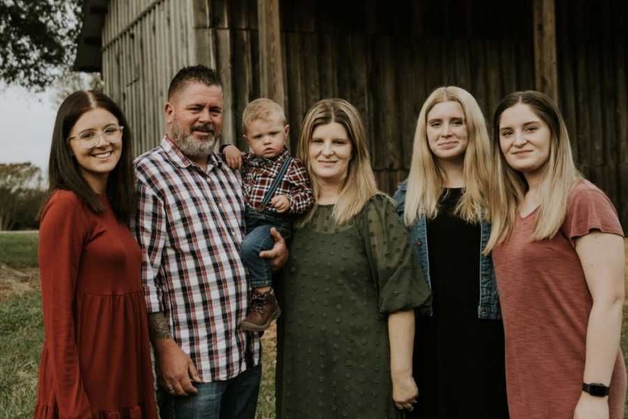 Family of 6 take photos together after adopting the boy they had been fostering