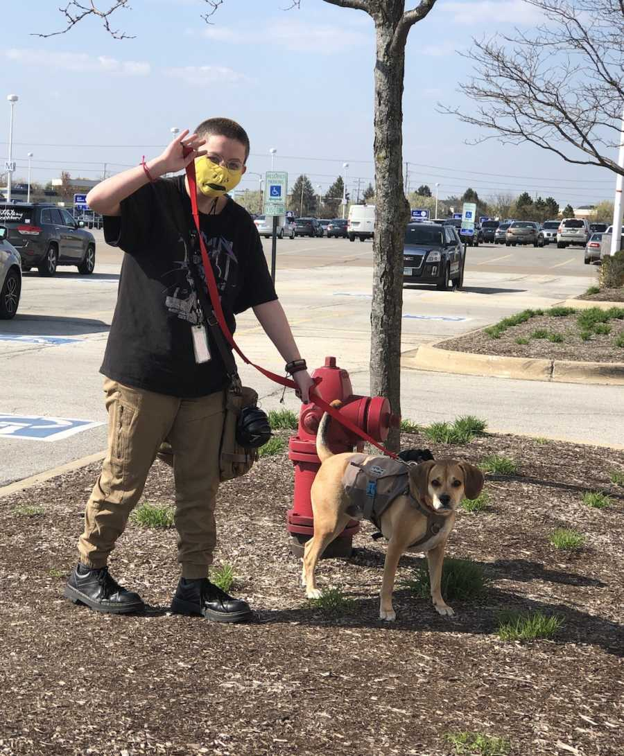 person walking dog with mask on