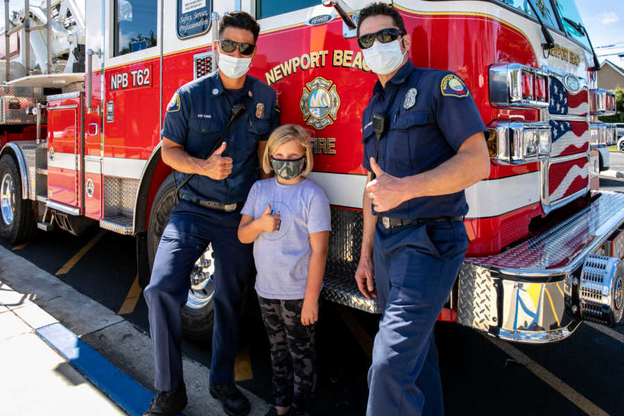 masked girl with two firefighters