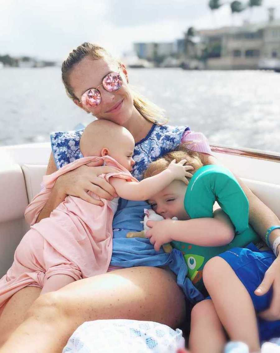 mom on boat with two children