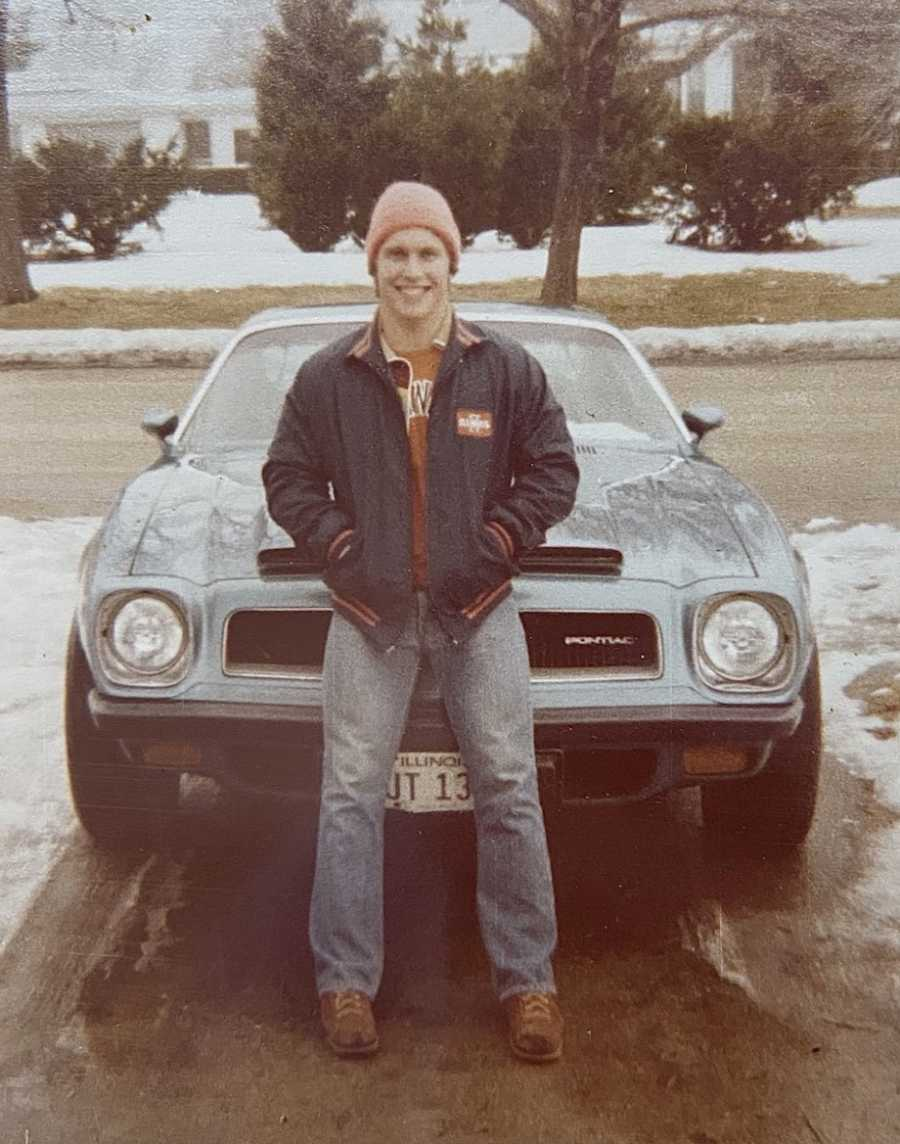 Dad posing on car