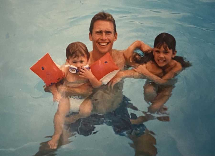 Dad with daughters in pool