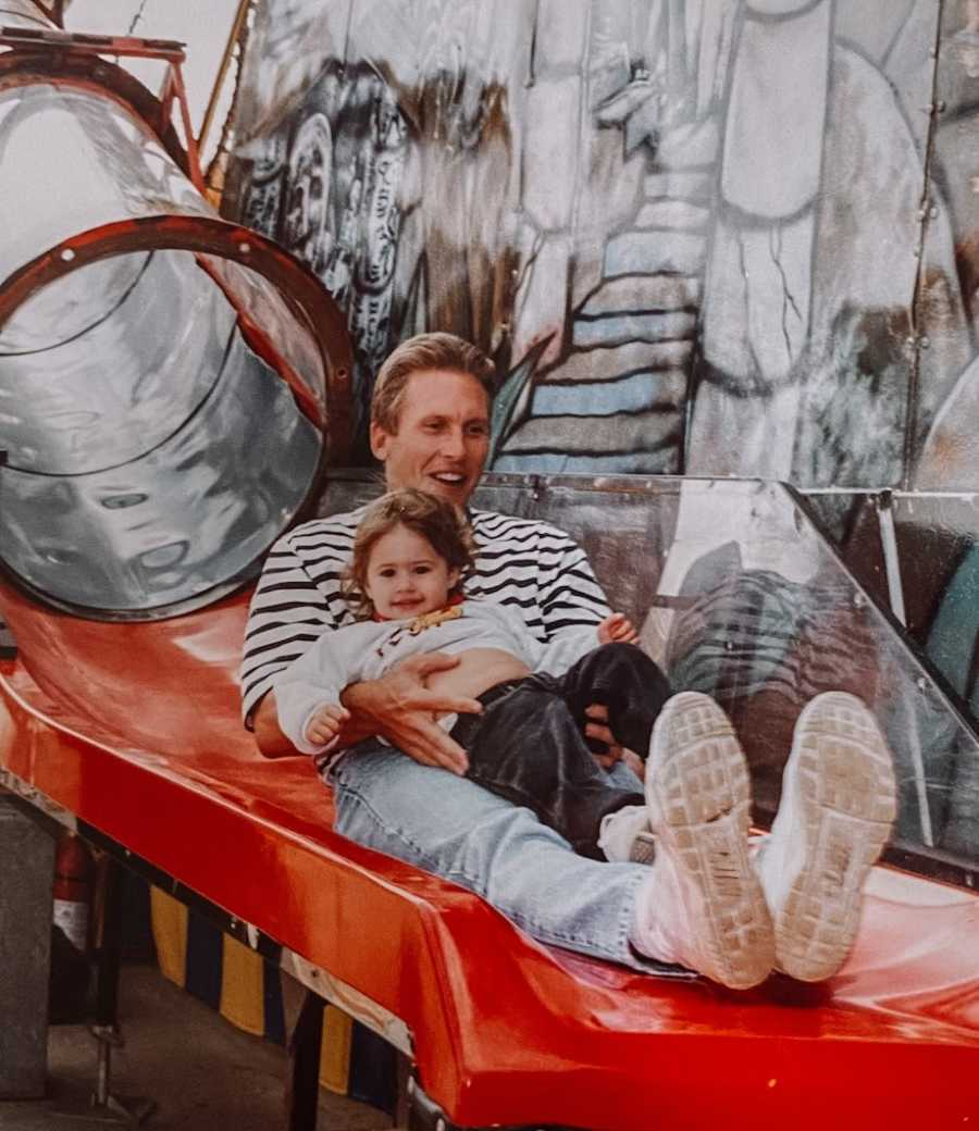 Dad and daughter on slide