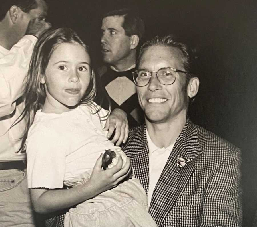 Black and white photo of dad holding daughter