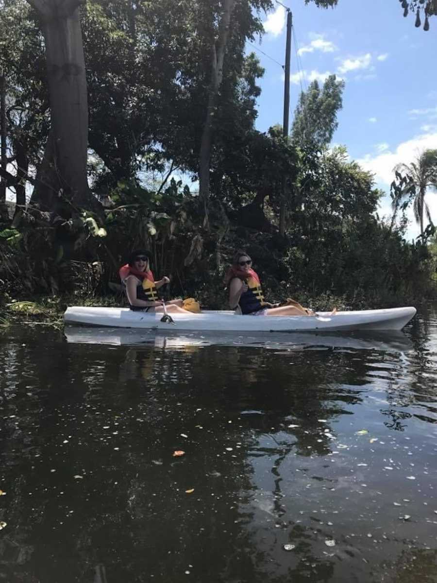Friends kayaking on vacation