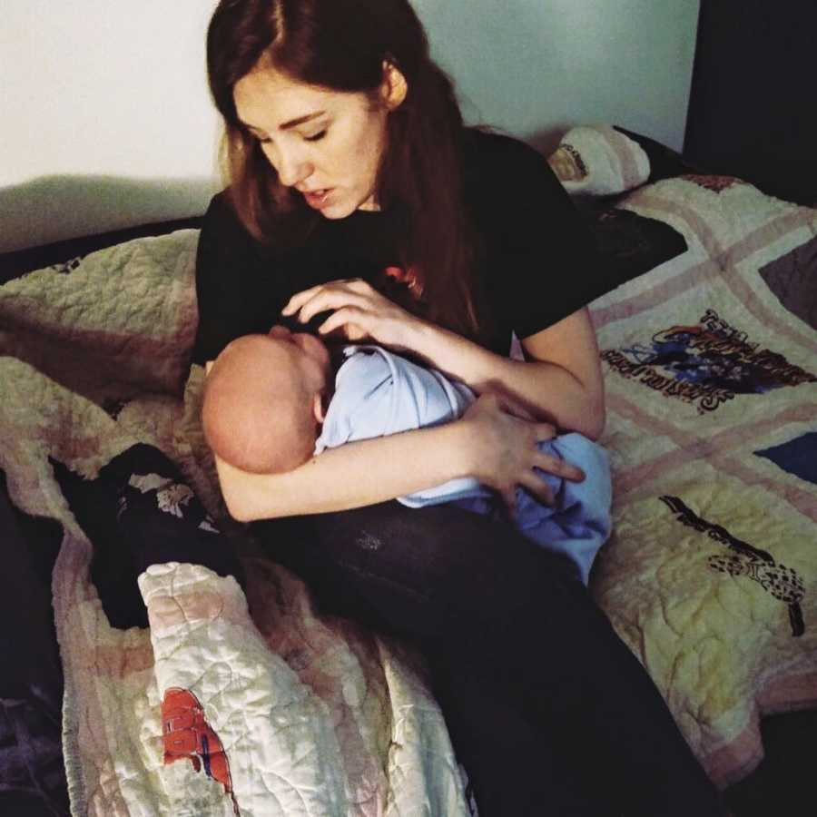 New mom comforts her newborn with a pacifier while rocking him