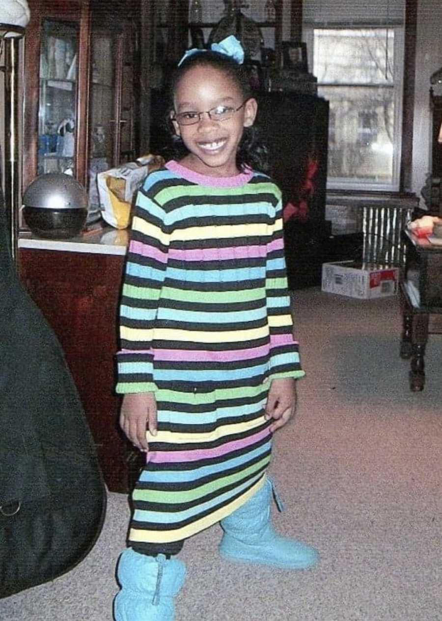 child in striped dress