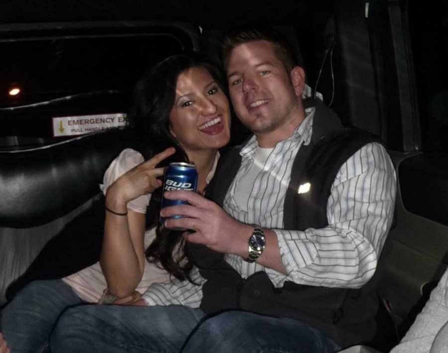 husband and wife in taxi, drinking
