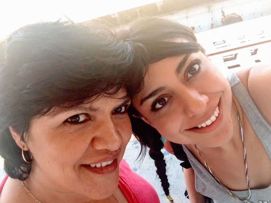 Woman takes a selfie with her mom, showing off how much they look alike