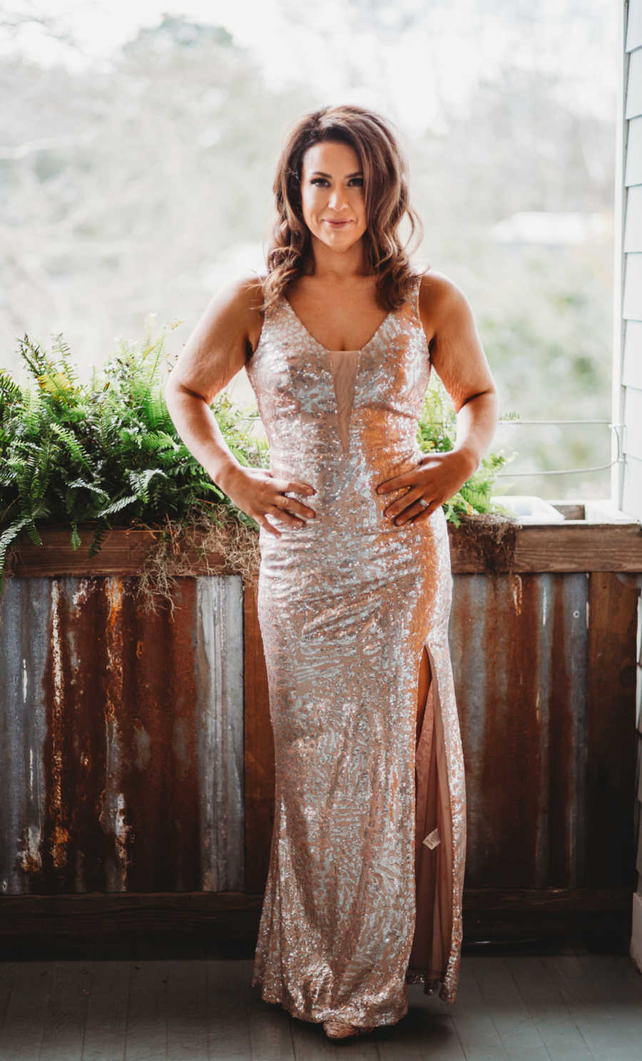 Woman takes photos in skin-tight sparkly gold dress, looking confident after weight loss journey