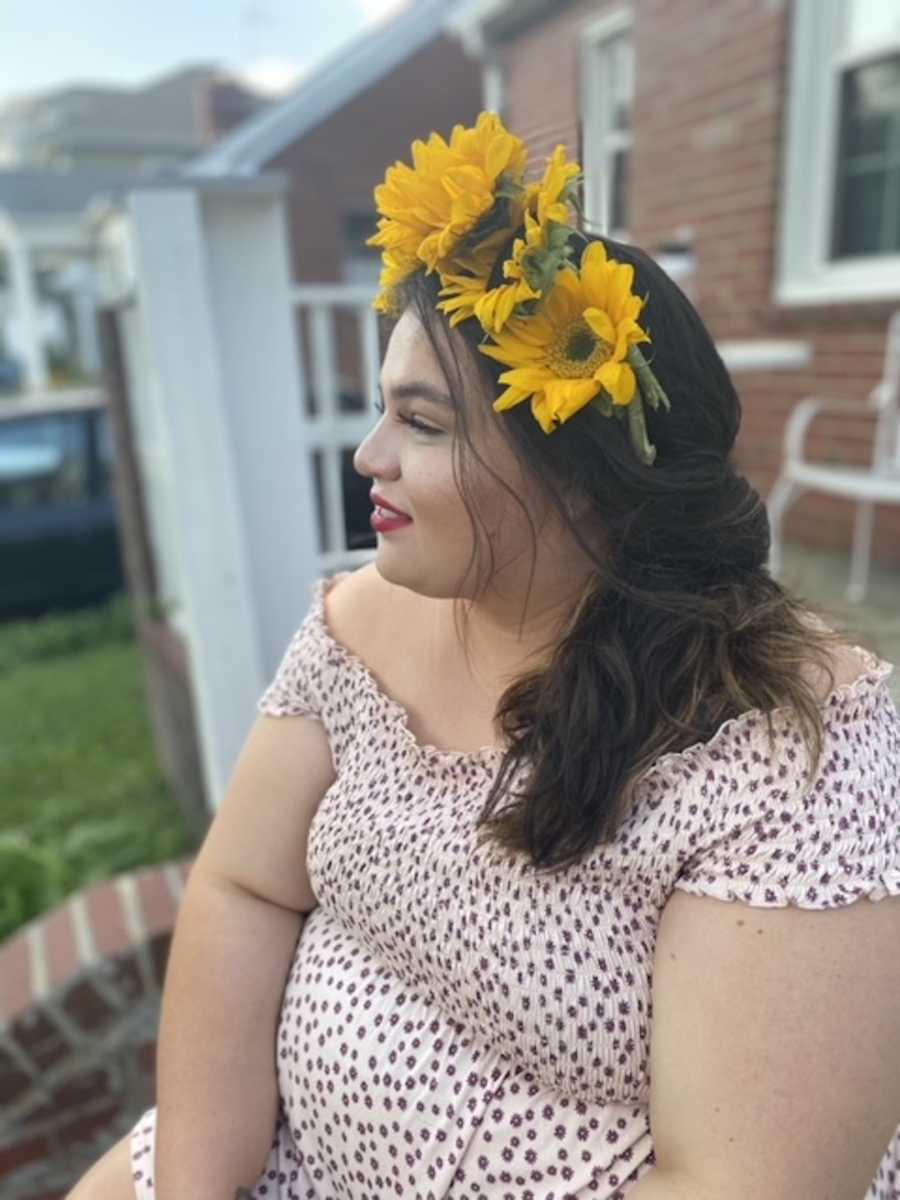 girl in flower crown looking to the side