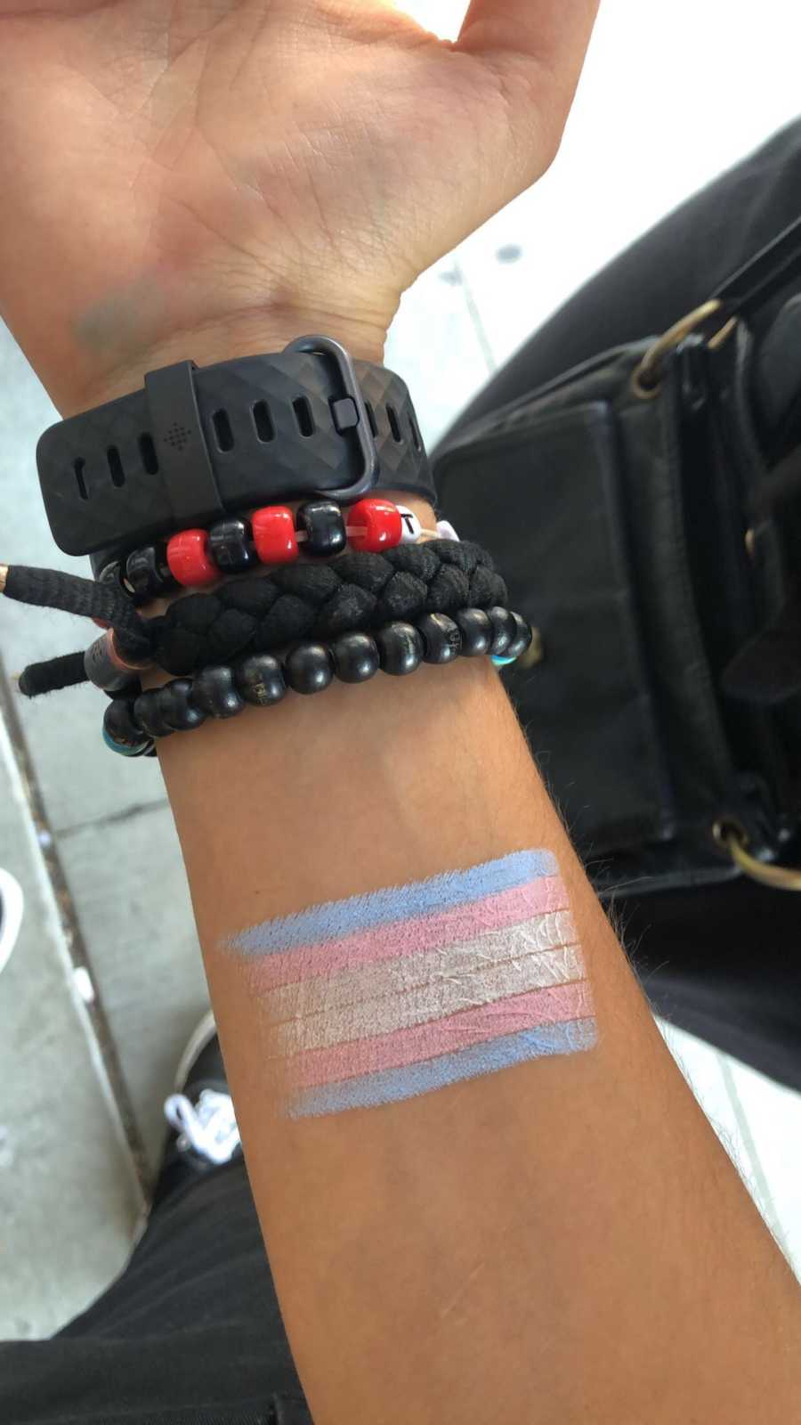 trans flag painted on a wrist