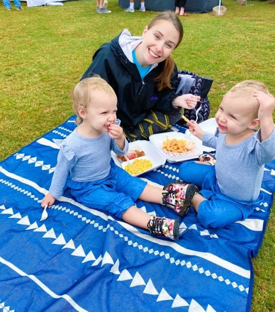 mom and her twins having a picnic