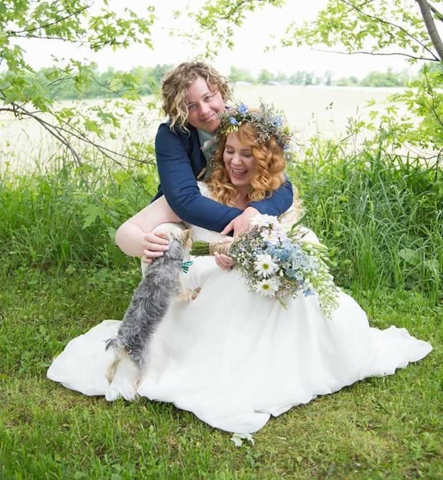 lesbian couple on wedding day by a lake