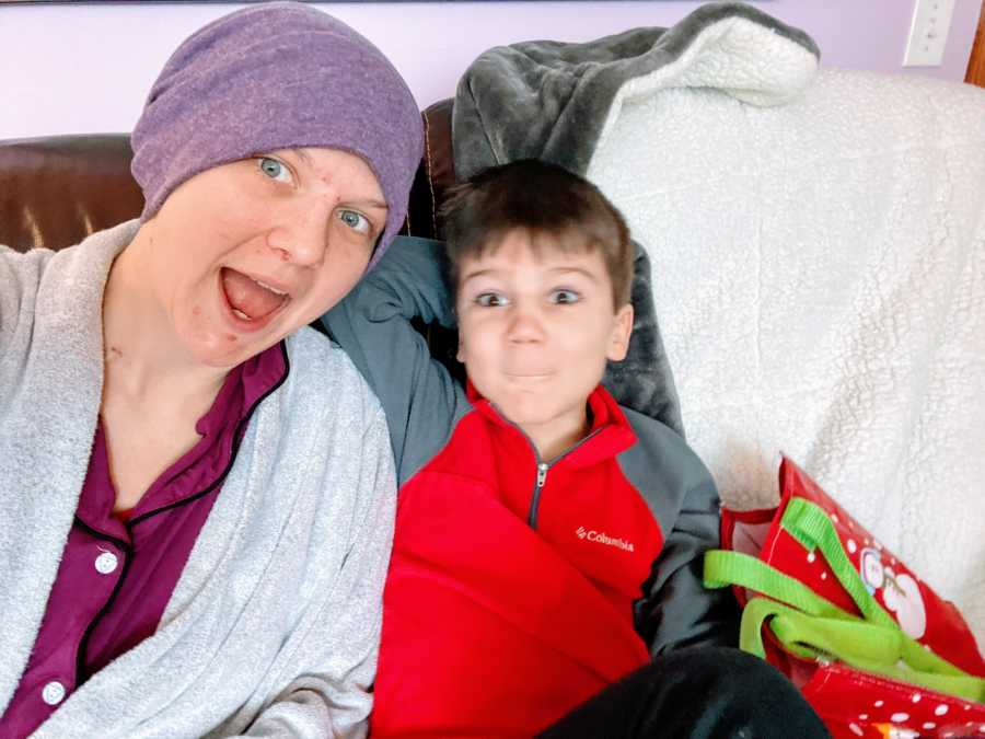 Mom battling breast cancer takes a selfie with her five-year-old son while they cuddle on the couch
