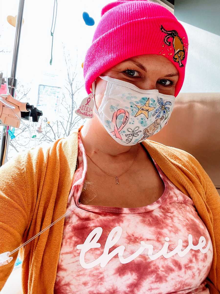 Woman battling breast cancer takes a selfie during chemotherapy