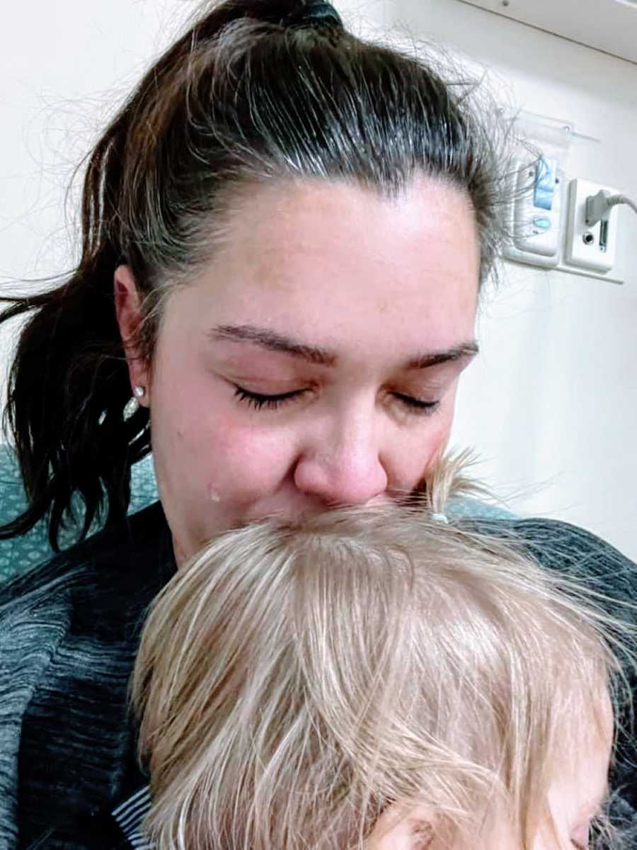 Mom holds her daughter who swallowed a button battery and cries