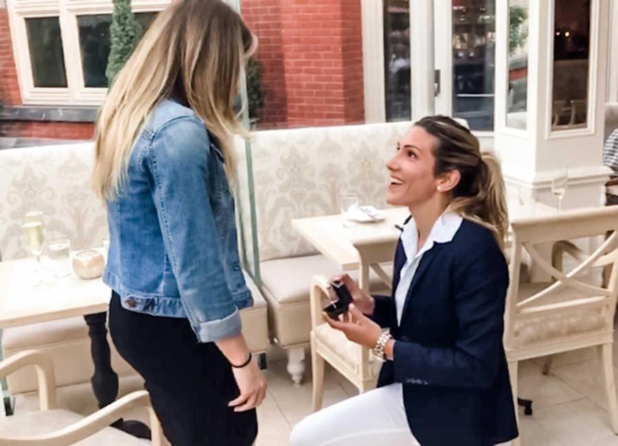 woman proposing to her girlfriend