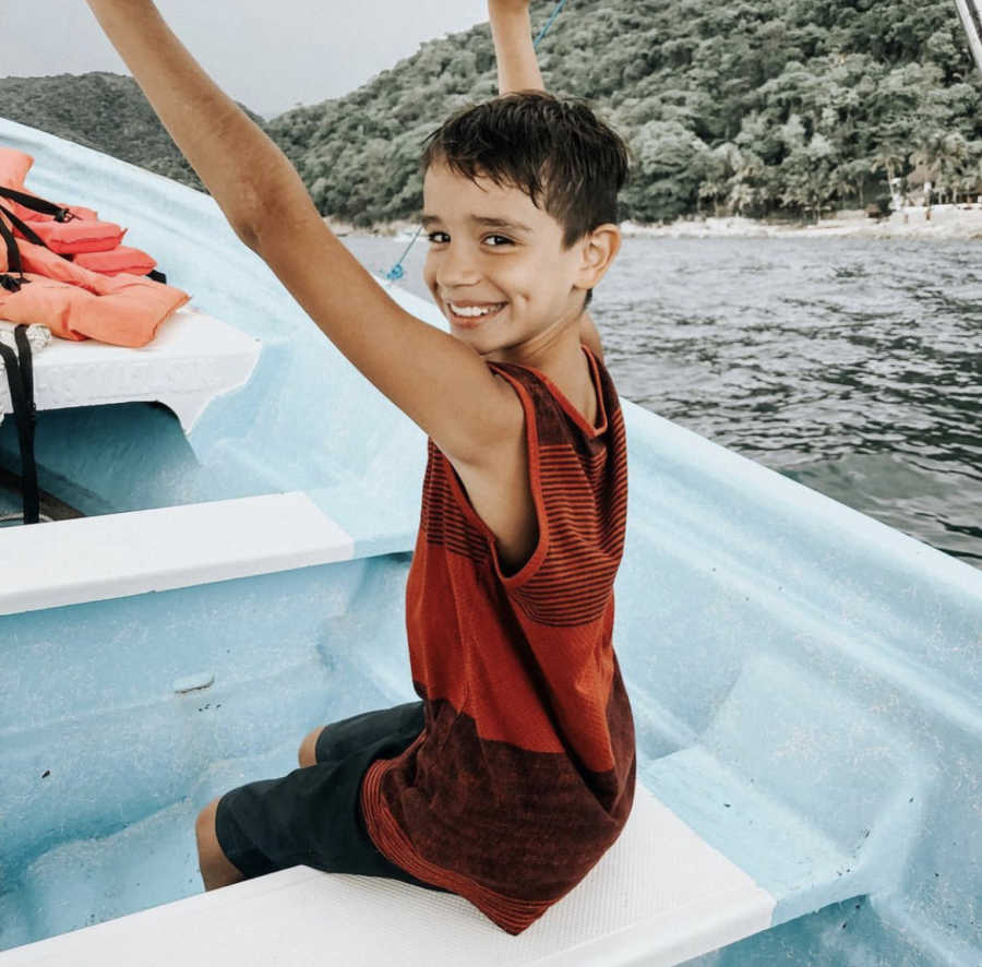 A young boy on a boat