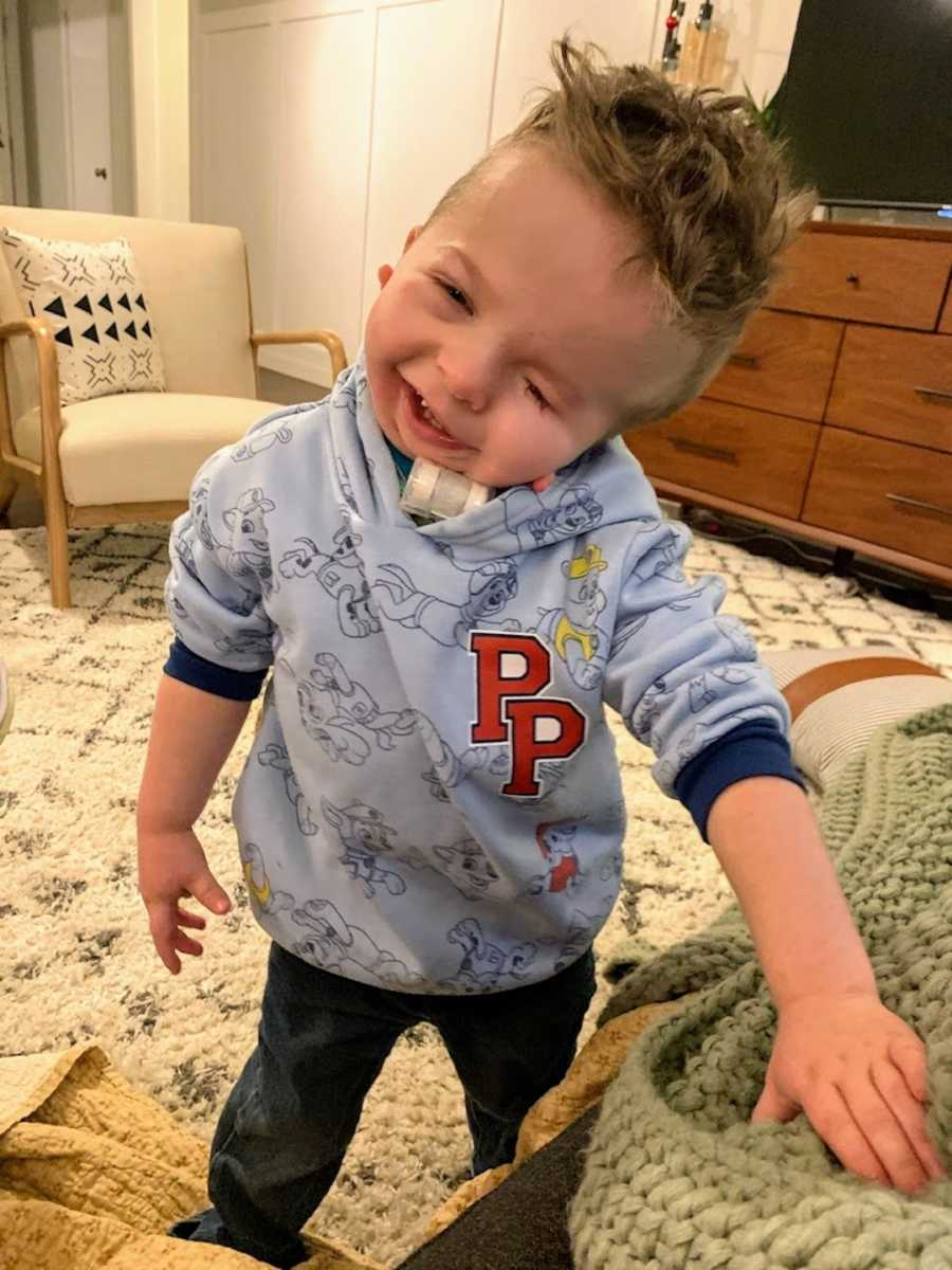 Young boy wearing Paw Patrol shirt smiling