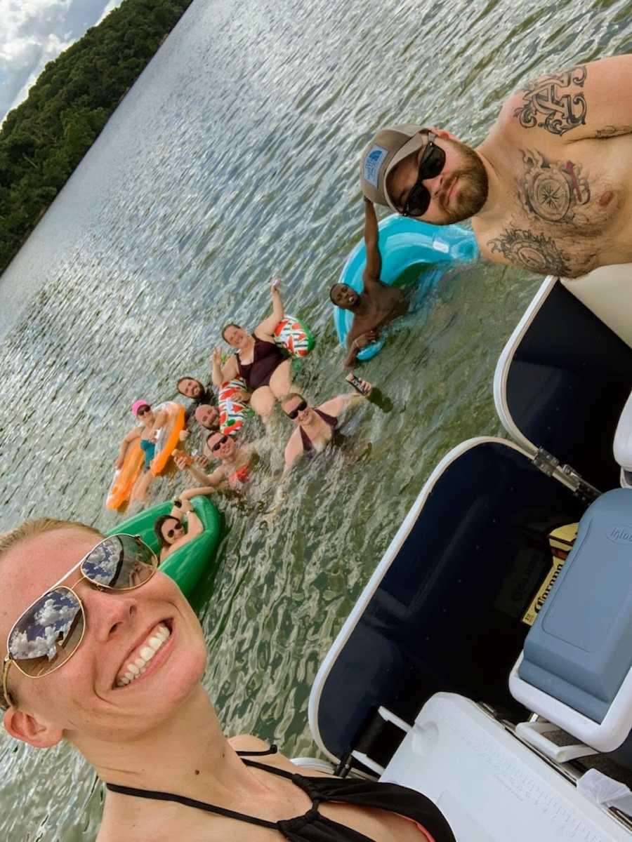 Blended family having lake day