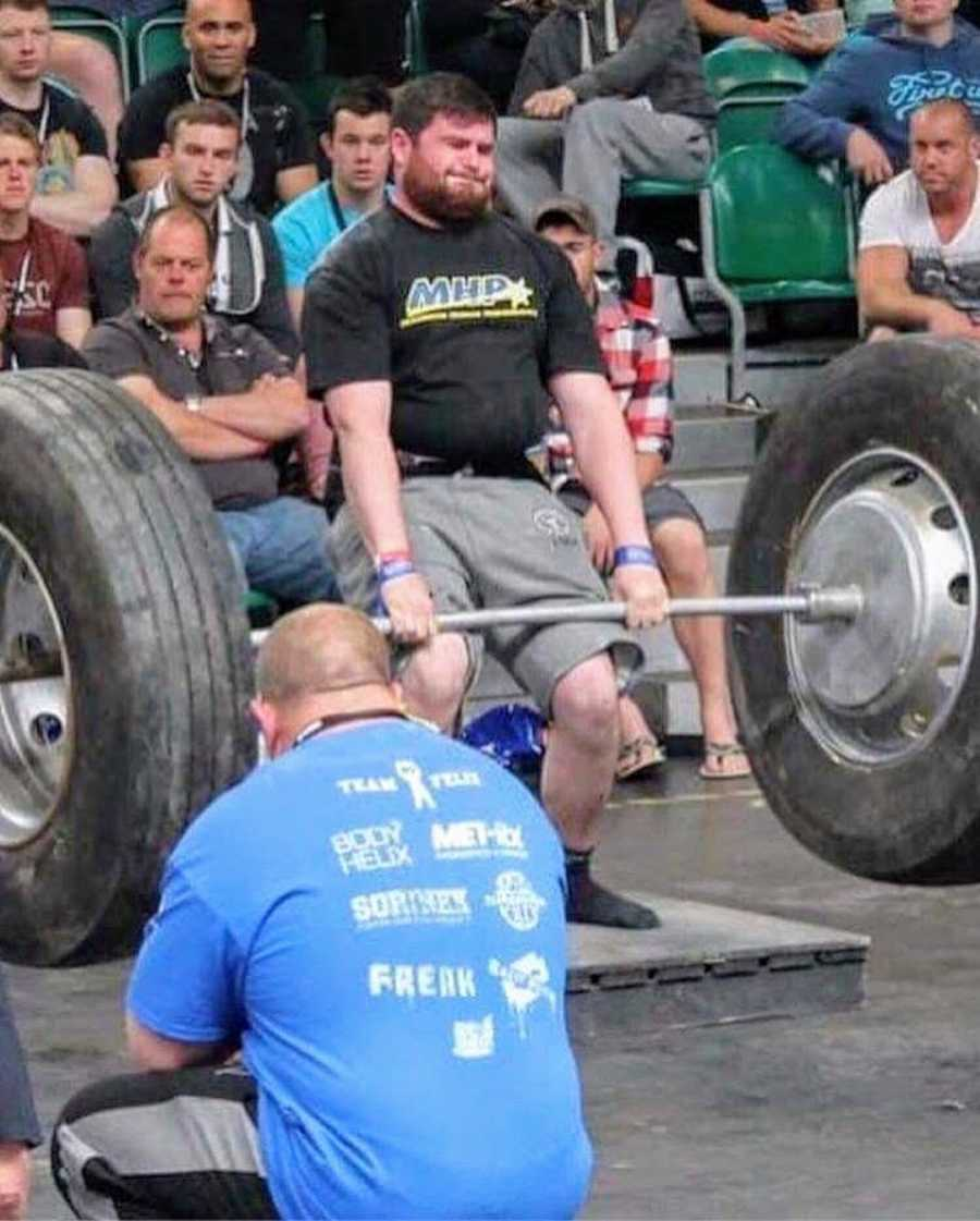 Man lifting weights at Strongman competition