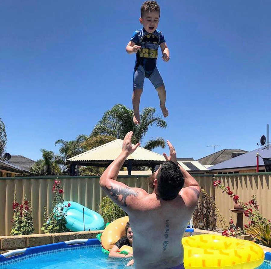Father in pool with son