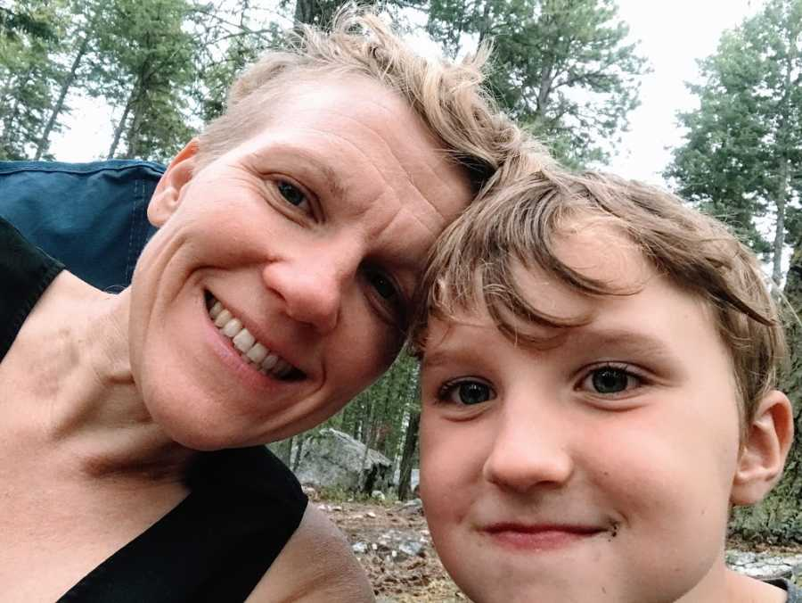 An autistic mom and her son in the woods