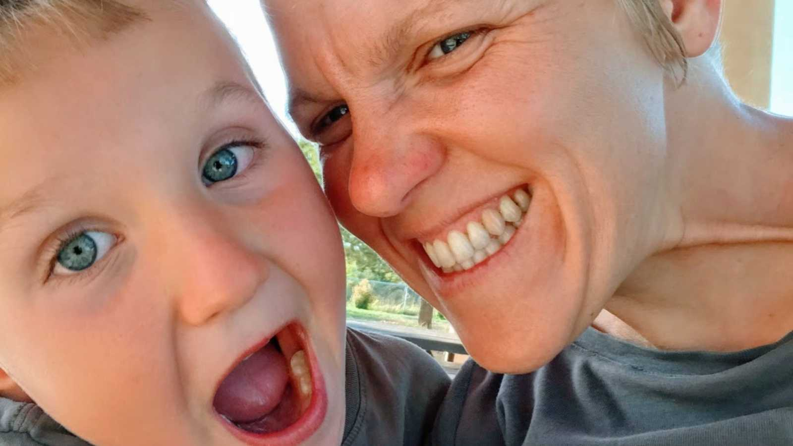 An autistic mom and her son make silly faces together